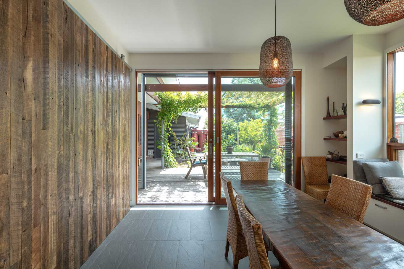 dining room with large windows towards backyard